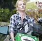 Super Bowl 2012: Charlize Theron hardly breaks a sweat as she carries a case of beer to a party  | Mail Online