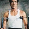 Bruce Lee with nunchucks.