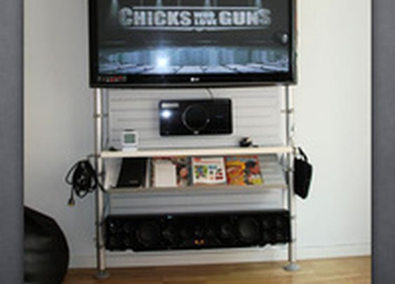 Mount Your HDTV on a Set of Floor-to-Ceiling Poles, Keep Your Wall Hole-Free