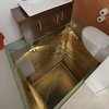 Glass floor in bathroom has illuminated view of 15-level elevator shaft - Boing Boing