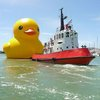 Real men put ginormous rubber ducks in boat pictures