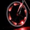 ThinkGeek :: Monkey Light 8-Bit Bike Wheel Light