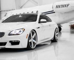 White 6-Series Coupe in a Hanger | CleanTuning.com