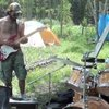 Coolest cop ever playing drums in the woods      - YouTube