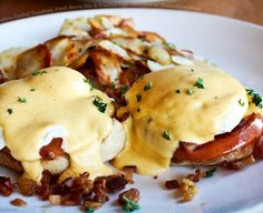 English Muffins, Grilled Tomatoes, Fresh Bacon Bits and Poached Eggs Drenched with Hollandaise Sauce