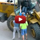 Drunk guy in a front end loader destroys parked cars, faces vigilante justice (video)