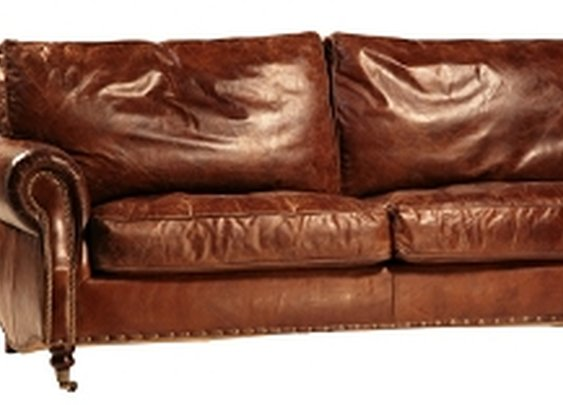 Antiqued Leather Sofa-The Salisbury Sofa is hand-finished in vintage leather accented with antiqued brass nail heads.