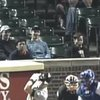 Fan Makes Blowjob Gestures Behind Home Plate