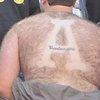 Appalachian St. fan shaves logo in back hair