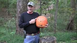 carving a pumpkin with a pistol