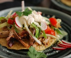 Pulled Pork Tostada with Slaw and Chipotle Cream