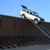 Smugglers try driving over US border fence, get stuck