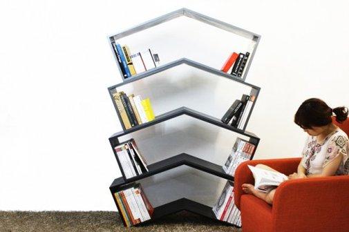 Elegant angled bookshelf needs no bookends