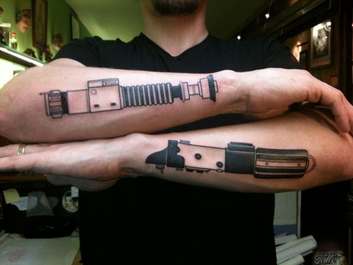 Dueling Lightsaber Arm Tattoos