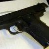 Loaded pistol found packed in frozen meat