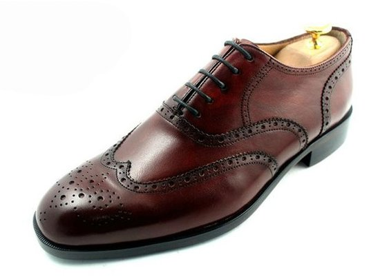 a classic English brogue with a wing tip and full broguing.