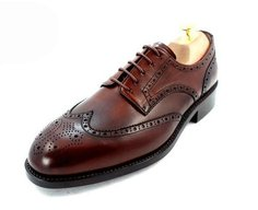a classic brogue shoe with punch pattern on the toe