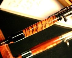 Bullet Pen in handcrafted zebra and padauk woods by Hope & Grace Pens