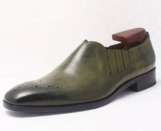 Olive Loafer with a punched medallion design on the toe