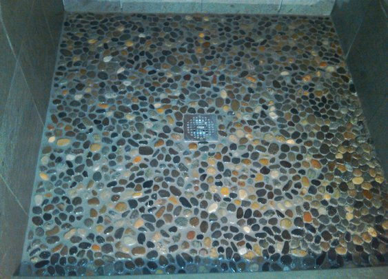 How to tile a shower floor using river rock