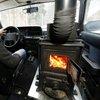 Zany Swiss man installs wood-burning stove in car