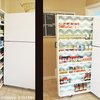 Space-Saving Roll-Out Pantry Between the Fridge and the Wall