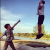 A kid 'vadering' his buddy - hehe