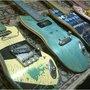 Recycled skateboard guitars