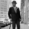 Muhammad Ali with Hat, Umbrella, and Spats