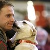 Marine reunited with dog he handled in Afghanistan in surprise ceremony