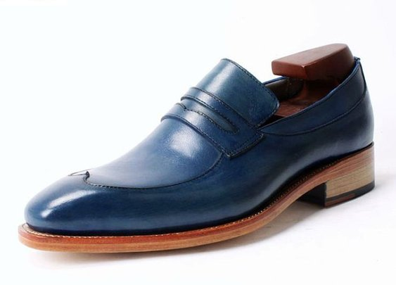 go sockless with a pair of navy blue penny loafer