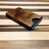 Wooden business card holder for pocket.  Check out the other stuff available at the site.