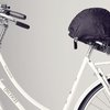 HelmMate secures your bike helmet and keeps your saddle dry