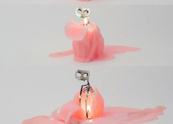 Tis The Season: Cat Candle Melts To Reveal Skeleton | Geekologie