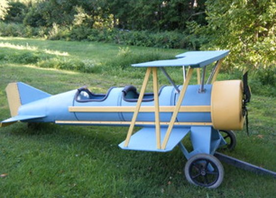 Cardboard barrel biplane. The Flyin' Lion