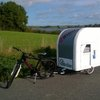 Lightweight caravan sleeps two adults, is towed by bicycle
