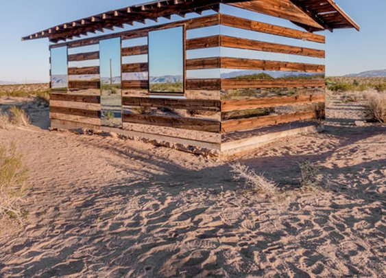 This Is What Happens When You Put Rows of Mirrors on a Shack in the Desert