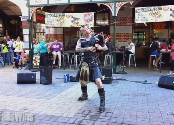 Street Performer Plays AC/DC's 'Thunderstruck' On Flaming Bagpipes