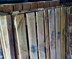 Man Remodels Floor With Recycled Wood Pallets (Photos)