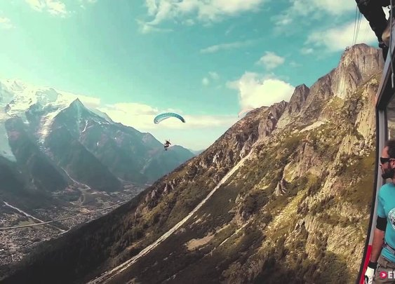 Daredevil parachutes into a moving cable car - YouTube