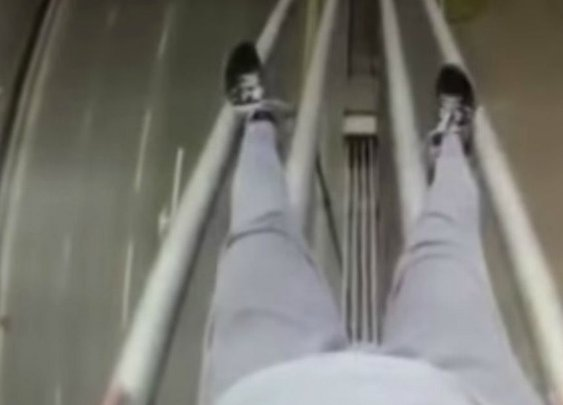 This is the moment two teenagers climb a 171ft bridge then slide down its cables - with no safety rope