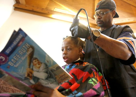 Dubuque barber gets kids reading with free haircuts