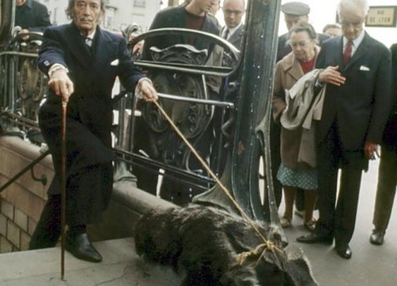 """Salvador Dali taking his anteater for a walk in Paris"""