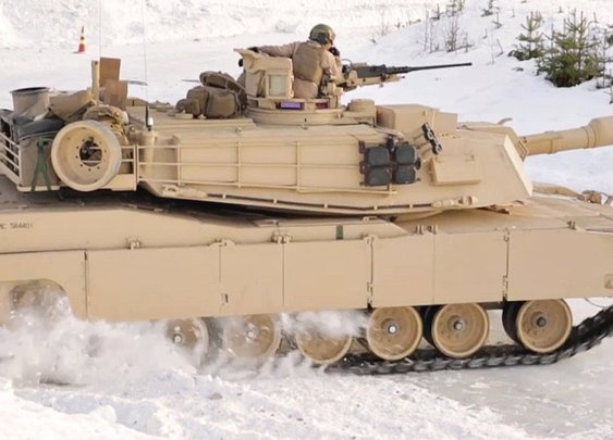 U.S. Marines Drift Their M1A1 Tanks on a Snowy Track for Training Purposes in Rena, Norway