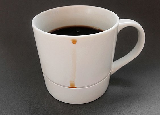 Clever Mug Catches Coffee Drips Before They Become Stains