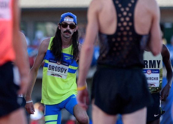 """Meet the Mustachioed, Beer-Drinking """"Hero"""" Who Crashed the Trials 10K"""
