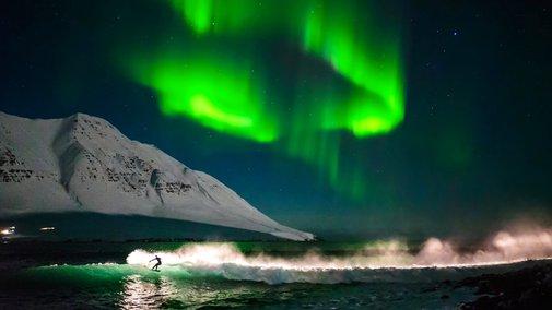 Surfing Under Northern Lights | That's Amazing
