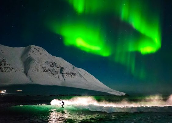 Surfing Under Northern Lights | That's Amazing