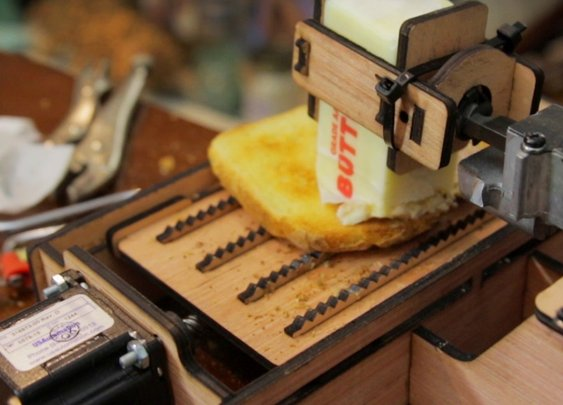Man Builds a Dangerous Toast Buttering Robot Using a Laser Cutter and a Powerful Jigsaw Motor