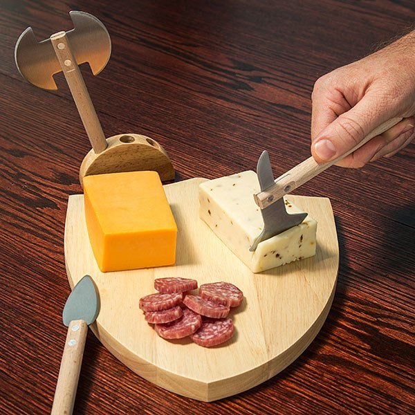 A Shield Shaped Medieval Cutting Board With Battle Axe and Spear Blades